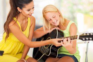 Business - image bigstock-smiling-beautiful-music-teache-46068454-300x200 on https://musicmasterlab.com