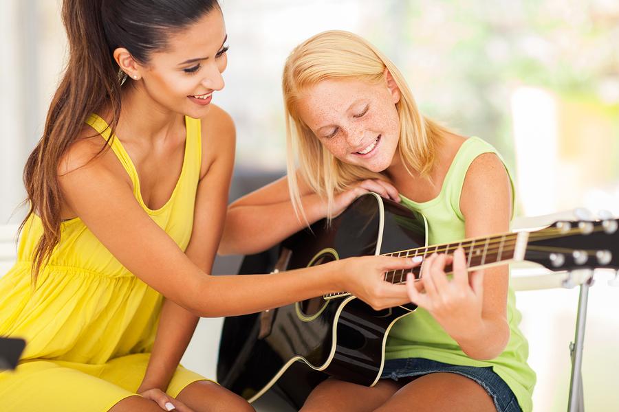 Recruiting New Private Music Students. - image bigstock-smiling-beautiful-music-teache-46068454 on https://musicmasterlab.com