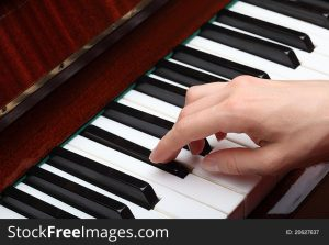 Adult Hand on Piano