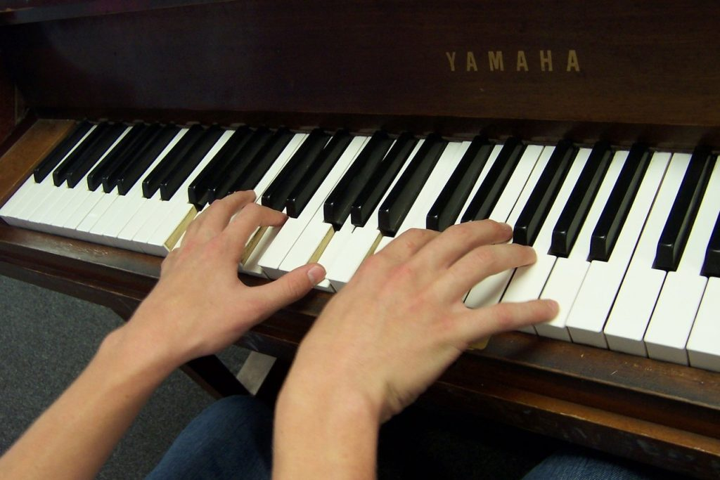 Creating a Thriving Private Music Studio. - image Adult-Hand-on-Piano_2-copy-1024x683 on https://musicmasterlab.com