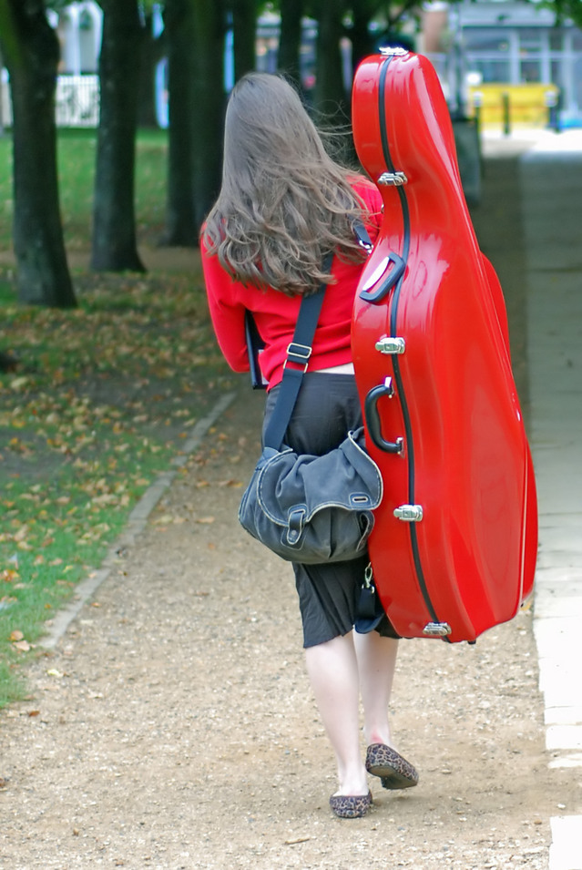 How to Pick a Private Music Studio Location. - image girl-with-cello-case on https://musicmasterlab.com